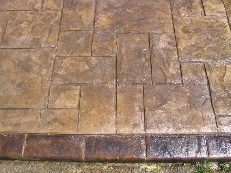 Grand Ashler Slate stamped finish with an acid stained boarder