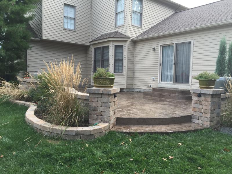 Grand Ashlar Slate stamped patio with low voltage lighting in walls.